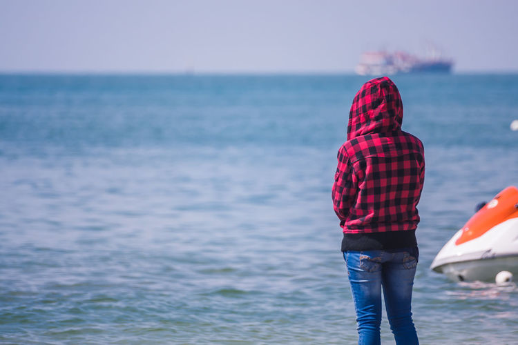 Young Girl With Plaid Jacket Standing Looking At The Sea. Beach Casual Clothing EyeEm Best Shots From My Point Of View Girl Horizon Over Water Leisure Activity Lifestyles Nature Outdoors People Plaid Jacket Sea Seashore Standing Sunlight Sunny The Best From Holiday POV Vacations Water Spring/Summer 2016 WeatherPro: Your Perfect Weather Shot Young