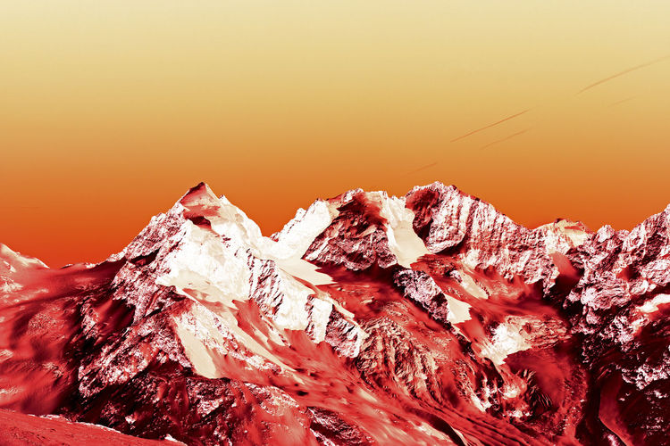 A view of fantastic colorized mountains in the switzerland No People Nature Sunset Sky Wood - Material Beauty In Nature Cold Temperature Rough Close-up Outdoors Orange Color Snow Rock Tranquility Winter Scenics - Nature Rock - Object Mountain Non-urban Scene Alps Fantasy Architecture Color Nature Landscape