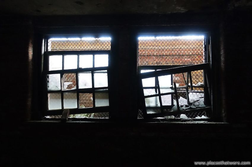 Looking through broken windows. http://www.placesthatwere.com/2017/12/abandoned-warner-and-swasey-company.html Broken Glass Abandoned Broken Window Brokenwindows Factory Windows Abandonedplaces Abandonedfactory Urbanexploration Urbex Decay Urbandecay Rust Belt Creepy Eerie Abandoned & Derelict Urban Exploration Industrial Decay Abandoned Buildings Cleveland Abandoned Places Ruins Ohio Window Indoors  Glass - Material Looking Through Window Architecture No People Day