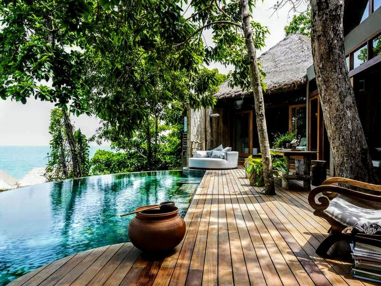 No People Luxury Swimming Pool Nature Tree Water Travel Destinations Tranquility Sunlight Vacations Outdoors Relaxation Sea Day Beauty In Nature Palm Tree Scenics Tropical Climate Architecture Sky
