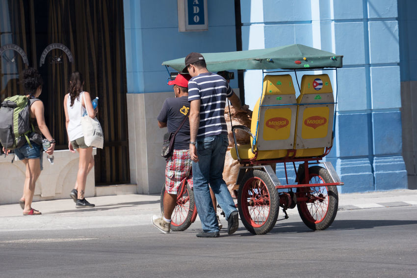 O, do I really need an object release by Maggi? I think, they don't have a license for that logo. Backpack Casual Clothing Cuba Cuba Collection Habana Men Prado Rear View Riksha Sunday Tourist Transportation Walking Around What A Pity! Women With Waterbottles Young Women