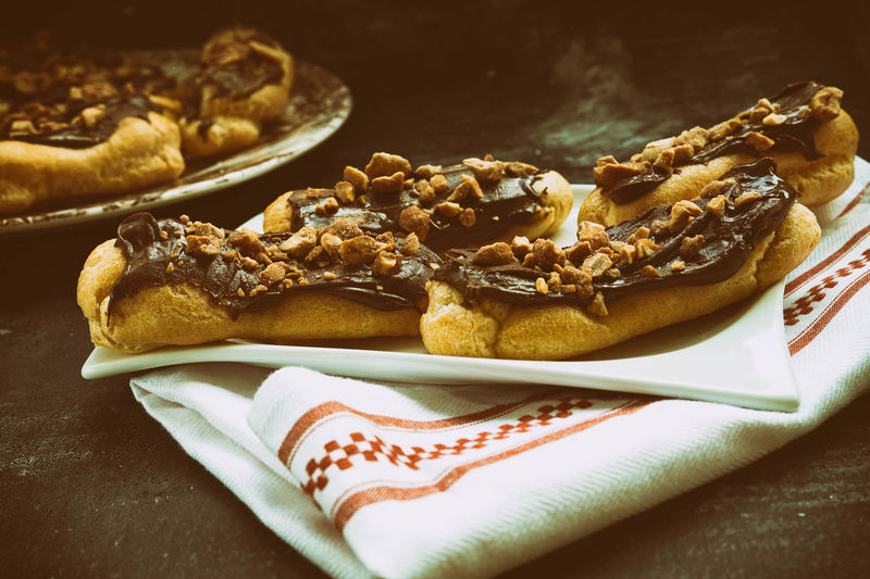High angle view of dark chocolate hazelnut eclairs