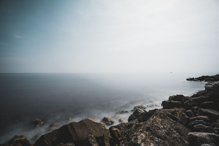 At The Edge Of Beach Beauty In Nature Copy Space Day Fog Horizon Horizon Over Water Land Nature No People Outdoors Rock Rock - Object Rocky Coastline Scenics - Nature Sea Sky Solid Tranquil Scene Tranquility Water