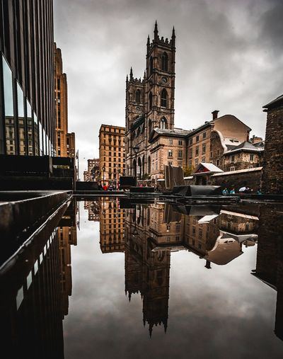 Reflection of mosque in city