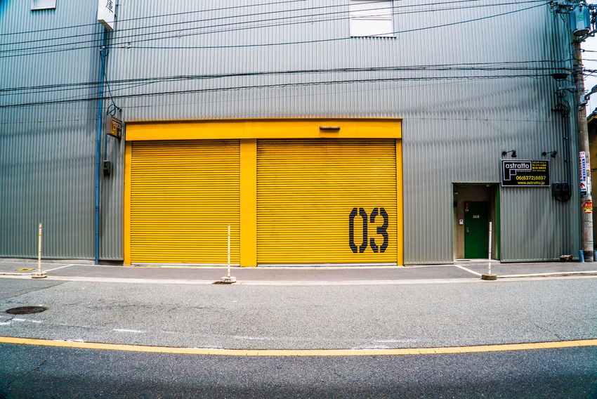 EyeEm Gallery EyeEmNewHere Architecture Building Building Exterior Built Structure City Closed Day Door Entrance Garage Industry Iron Marking No People Outdoors Road Road Marking Sign Street Streetphotography Symbol Transportation Yellow The Still Life Photographer - 2018 EyeEm Awards The Street Photographer - 2018 EyeEm Awards