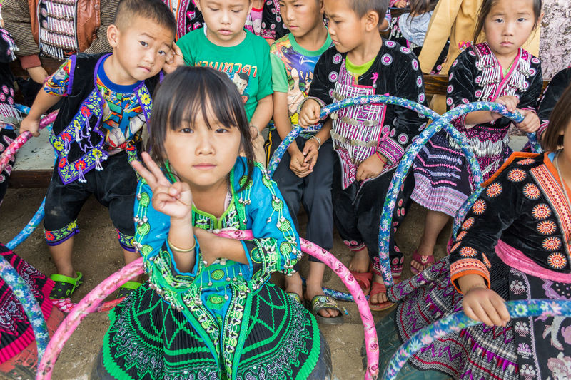 Chiangmai Thailand Tribal Adult Boys Cheerful Child Childhood Day Enjoyment Friendship Girls Happiness Lifestyles Looking At Camera Multi Colored Outdoors People Portrait Real People Smiling Standing Togetherness Tribal Village Tribals