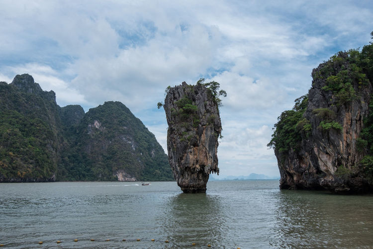 Water Beauty In Nature Scenics - Nature Sky Cloud - Sky Tranquil Scene Tranquility Waterfront Sea Rock No People Day Nature Non-urban Scene Solid Idyllic Rock - Object Rock Formation Outdoors Stack Rock Eroded James Bond Travel Island