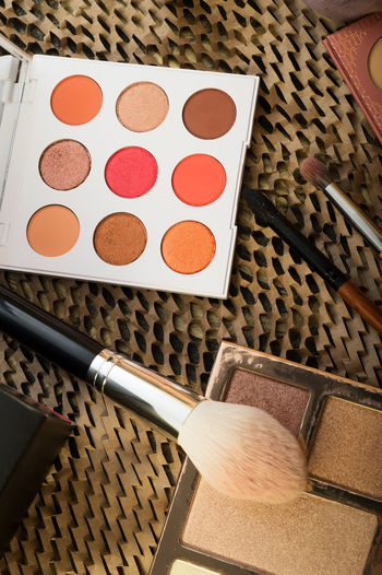 fashion set of new cosmetics eyeshadows palettes with brushes. close up Indoors  High Angle View Still Life Table No People Make-up Container Close-up Art And Craft Choice Variation Palette Beauty Product Personal Accessory Food Make-up Brush Creativity Food And Drink Brown Paintbrush