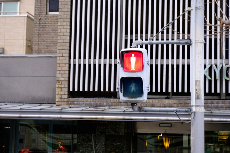 Stoplight against building in city