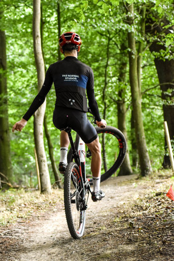 Bicycle Transportation Sport One Person Tree Full Length Activity Riding Helmet Cycling Lifestyles Ride Headwear Day Leisure Activity Nature Sunglasses Sports Helmet Plant Outdoors WoodLand Wheelie MTB Mountain Bike EyeEm Nature Lover
