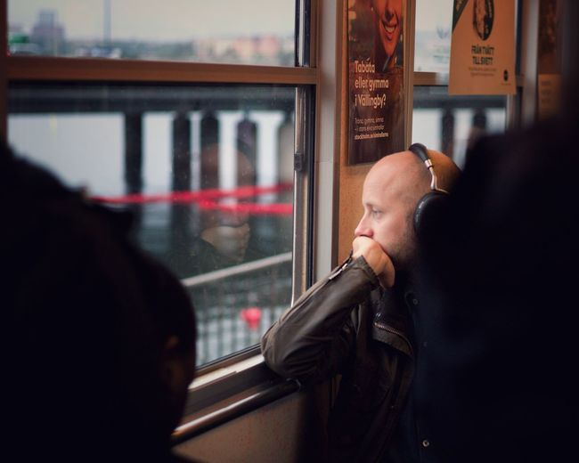 Morning commute Headphones Subway Melancholy Urban Leica Street Window Reflection Real People Lifestyles Glass - Material People Mode Of Transportation Portrait Train Public Transportation Adult