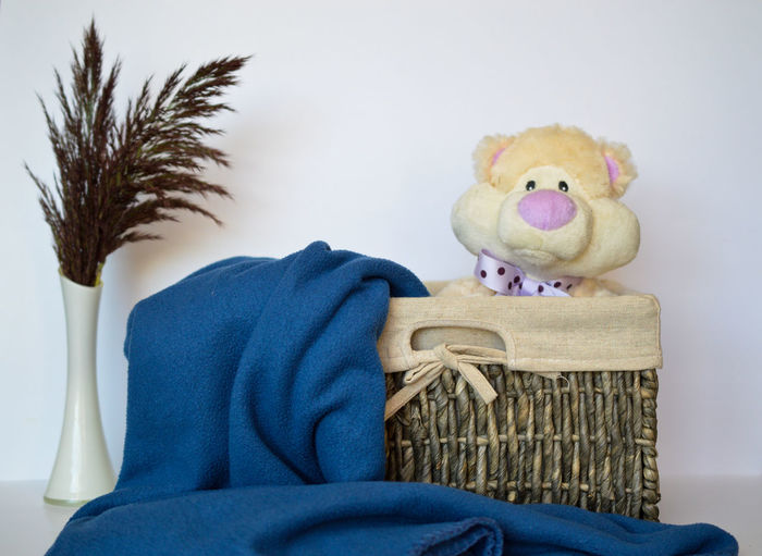 Close-up of stuffed toy on table against wall at home