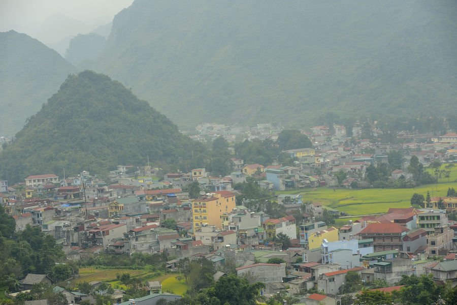 Beautiful View of Quan Ba town in Ha Giang district during cloudy and foggy morning. Witness of the twin mountain . The road is the gateway to the Dong Van Karst Plateau Geopark Quản Bạ World Heritage Site By UNESCO Unesco Landscape Geopark Town Paddy Fields Architecture Building Exterior Built Structure Building Fog Mountain Tree Plant Residential District Day Nature No People House City Outdoors Environment High Angle View Beauty In Nature Cityscape TOWNSCAPE