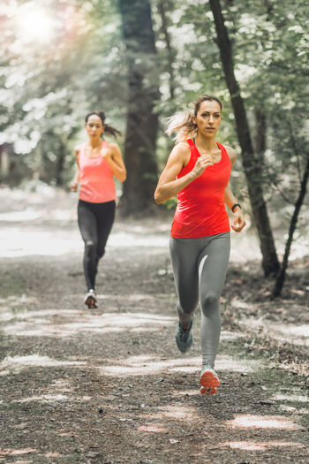 Women Jogging Outdoors in Park Jogging Running Woman Park Fitness Exercise Recreation  Sport Outdoor Workout Lifestyle Female Healthy Training Jogger Fit Active Run Athlete Nature Athletic Sporty Happy People Activity