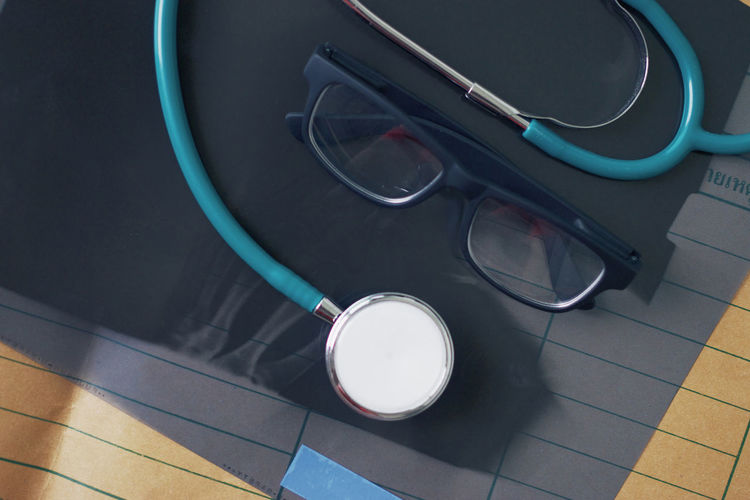 High Angle View Of Stethoscope And Eyeglasses