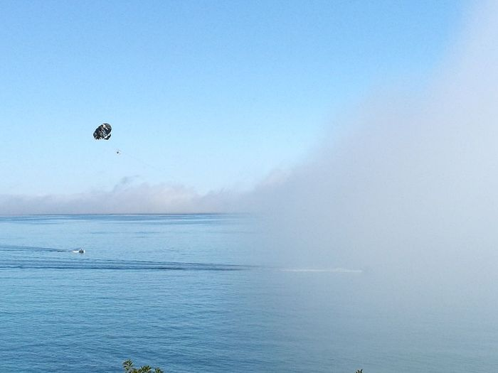 Water Beauty In Nature Nature Outdoors Fog Flying Mid-air Blue Scenics Landscape One Person Day Sky People Seascape Adventure Parachute Watersport Mist