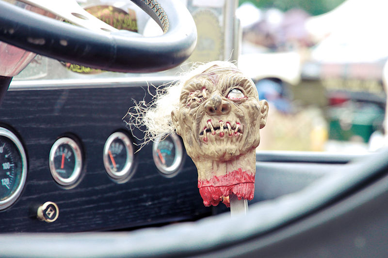 Close-up portrait of happy man in car