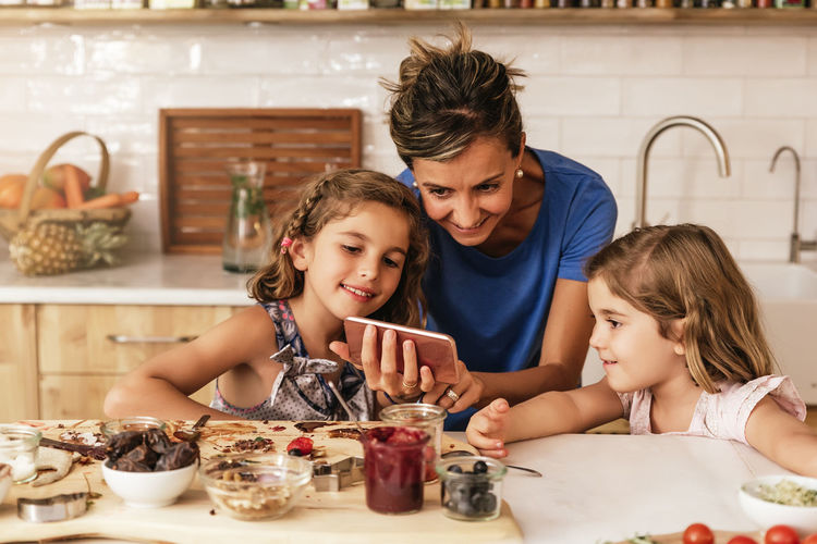 Childhood Child Family Females Women Togetherness Parent Bonding Food And Drink Mother Indoors  Girls Food Lifestyles Real People Daughter Kitchen Smart Phone Happiness Selfie Cooking Having Fun Copy Space Blonde Caucasian