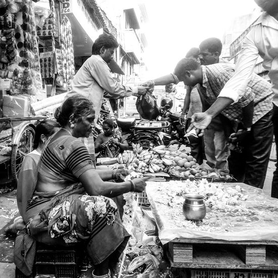 Perspectives And Dimensions EyeEm Gallery Dramatic Angles Perfect Timing First Eyeem Photo Drastic Angles Monochrome Photography EyeEm Best Shots Things I See From My Point Of View Best EyeEm Shot Femalephotographerofthemonth Black And White Photography Portrait Of A Woman Selling On The Street Saleswoman Sales Time Flower Shop Women Portraits Women Selling Stuff Streetphotography Streetphoto_bw Black And White Portrait Culture Of India Indian Street Photography