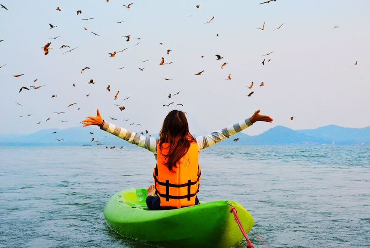 Live For The Story Sea Real People Flying Sky Outdoors Beach Nature Beauty In Nature Bird Horizon Over Water Day Water One Person Sitting Large Group Of Animals Animal Themes Clear Sky Nautical Vessel Adult People