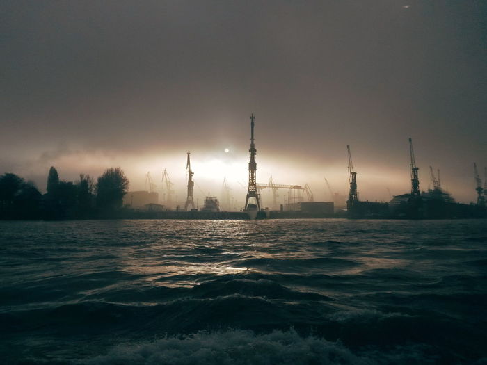 Hamburg Harbor Harbour Moody Sky Architecture Beauty In Nature Built Structure City Cloud - Sky Dusk Mood Moody No People Outdoors Pollution Sea Silhouette Sky Sunset Water Waterfront EyeEmNewHere Capture Tomorrow