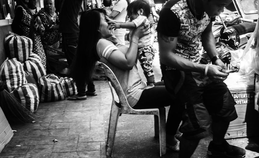 The things you see on the streets Black And White Blackandwhite Photography Candidshot City Life Eye4photography  EyeEm Gallery Eyeem Philippines People People Photography Playing With A Baby Street Photography Streetphoto_bw Streetphotography_bw The Street Photographer - 2016 EyeEm Awards