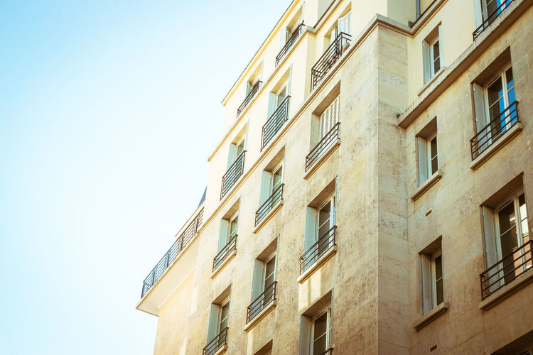 Parisien exterior Building Exterior Architecture Window Built Structure Low Angle View Sky No People Building Clear Sky Nature Residential District Day Outdoors City Copy Space Sunlight Pattern Apartment Balcony In A Row Paris France Europe 30s Art Deco Architecture Ironwork  Marble Stone Light And Shadow Lines Rectangle