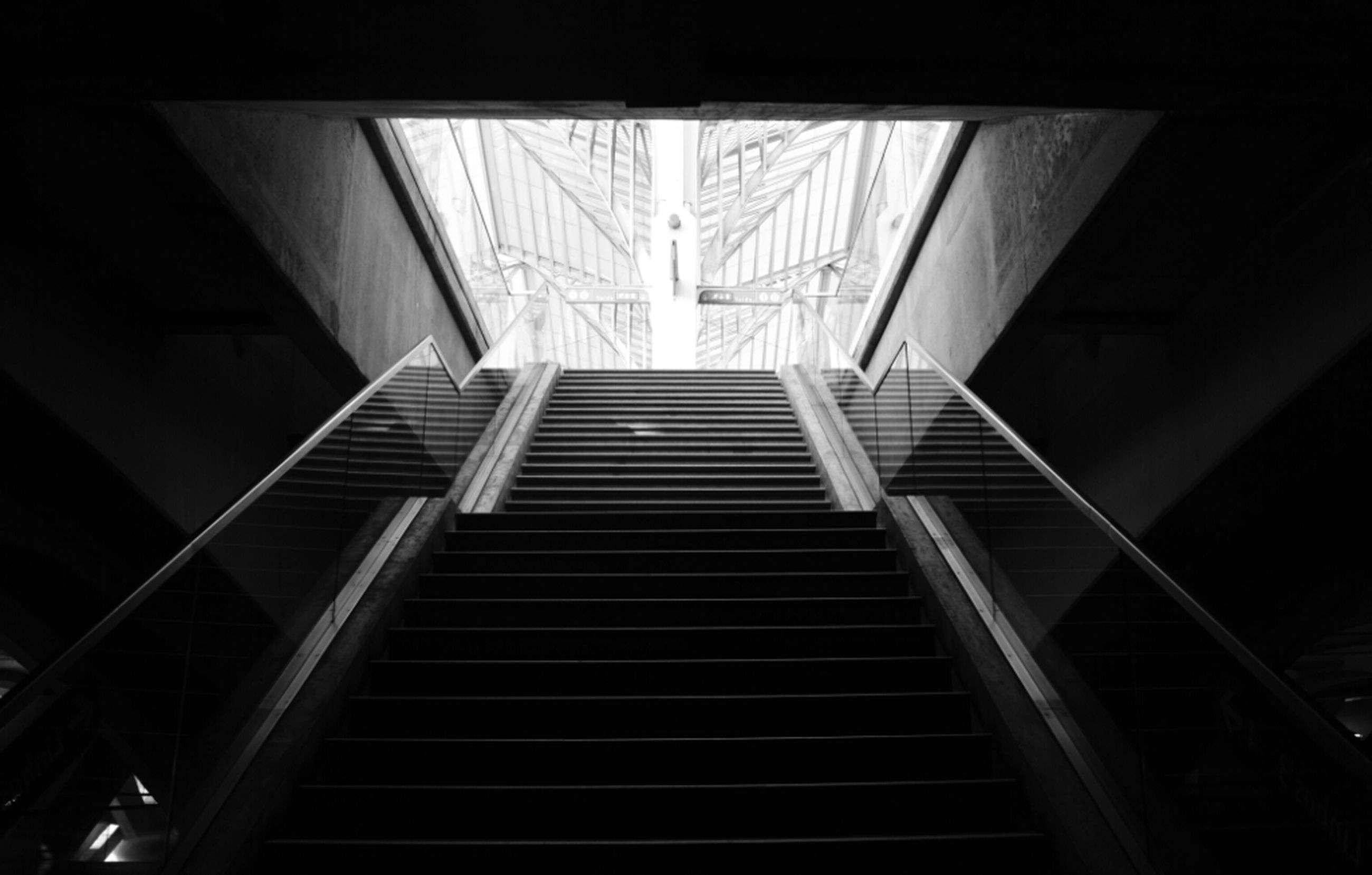 architecture, built structure, low angle view, indoors, staircase, steps and staircases, steps, railing, building, modern, building exterior, pattern, diminishing perspective, no people, metal, directly below, the way forward, stairs, ceiling, day