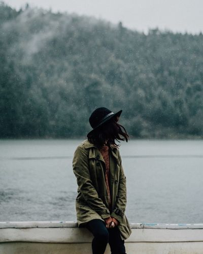 Weather Water One Person Outdoors Day Focus On Foreground Sky Nature Lake Tree Fog Young Adult Warm Clothing Young Women One Young Woman Only Adult People
