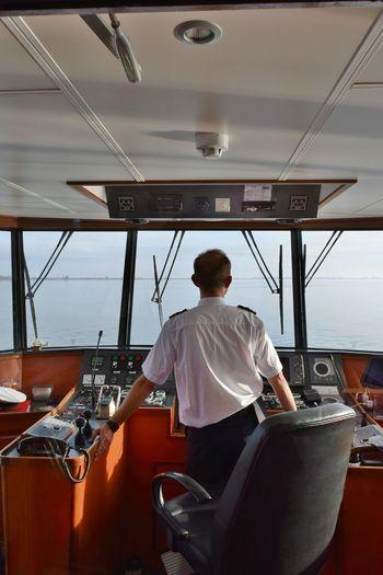 Captain Deck Indoors  Instruments Men Navigation On Course One Man Only One Person People River Boat Sailing Sailor Ship Skipper Transportation