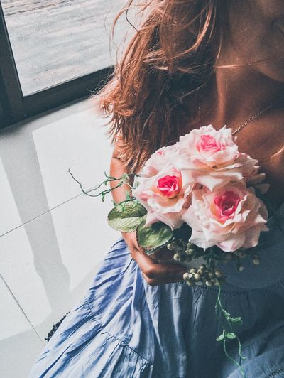 High angle view of woman holding rose bouquet