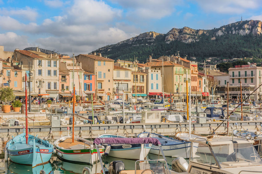 Architecture Boats Built Structure Cassis City Cityscapes France French Riviera Harbour Mountain Range Nature Nautical Vessel Port Residential District Sea And Sky Sky Town TOWNSCAPE Tranquility Travel Destinations Water