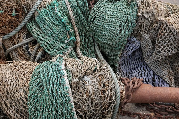 High angle view of fishing net in boat