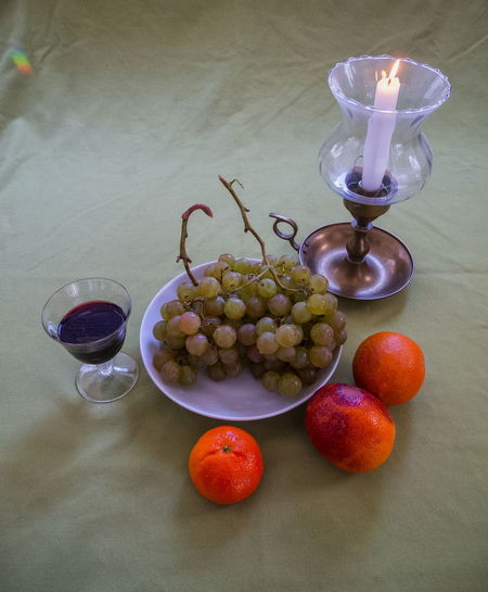 Still life with rainbow Candle Drinking Glass Food And Drink Fruit No People Still Life Table Wineglass
