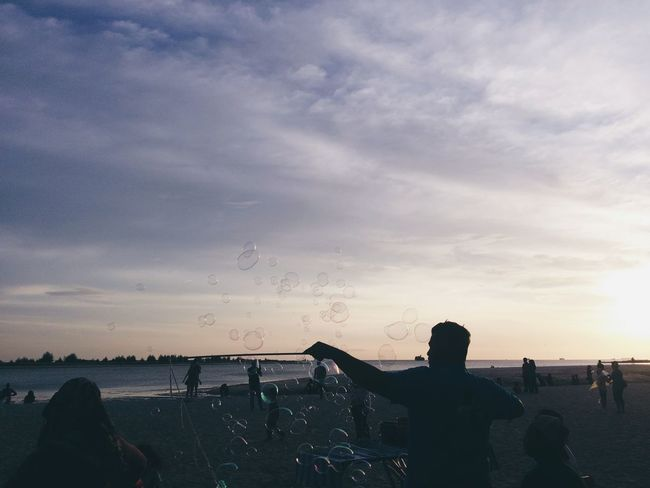 In Klebang, Malacca, Malaysia. Sunset Cloud - Sky Silhouette Water Sky Nature Beauty In Nature Sand VSCO Cam VSCO Phone Photography Scenics Landscape Bubbles Purple Sky Tranquility Nature Sunlight Silhouette Tourism Travel Destinations Dramatic Sky The Week On EyeEm