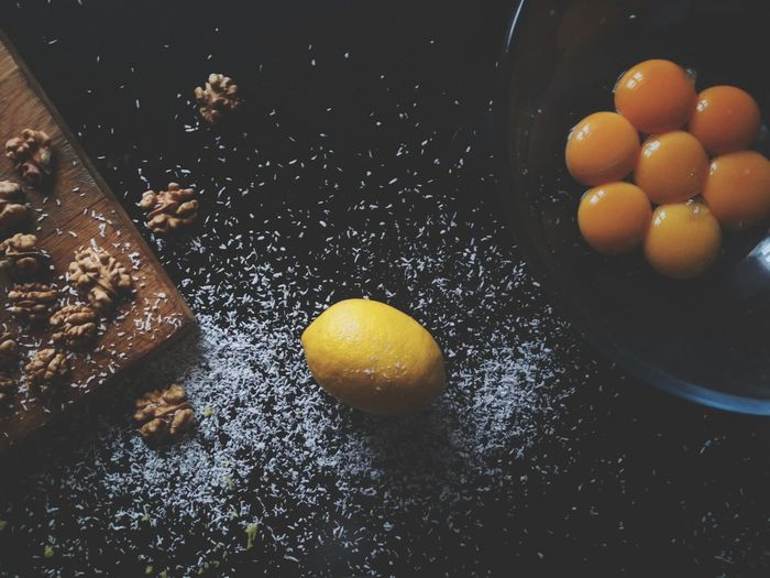 Kitchen Table Lemon Egg Yolk Coconut Flakes Walnuts Black Background Flat Lay Baking Ingredients Yellow Indoors  Food And Drink Fruit Food No People Citrus Fruit Food Stories