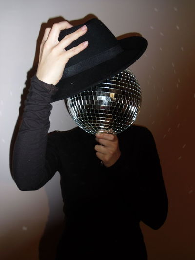 The lone Party Disco Disco Ball Minimalism Portrait Portraits Conceptual Conceptual Photography  Costumes Hat Attire Better Look Twice Person From My Point Of View This Week On Eyeem Glitter Ball People Person Lady Model Modeling Woman Hats Hat Models