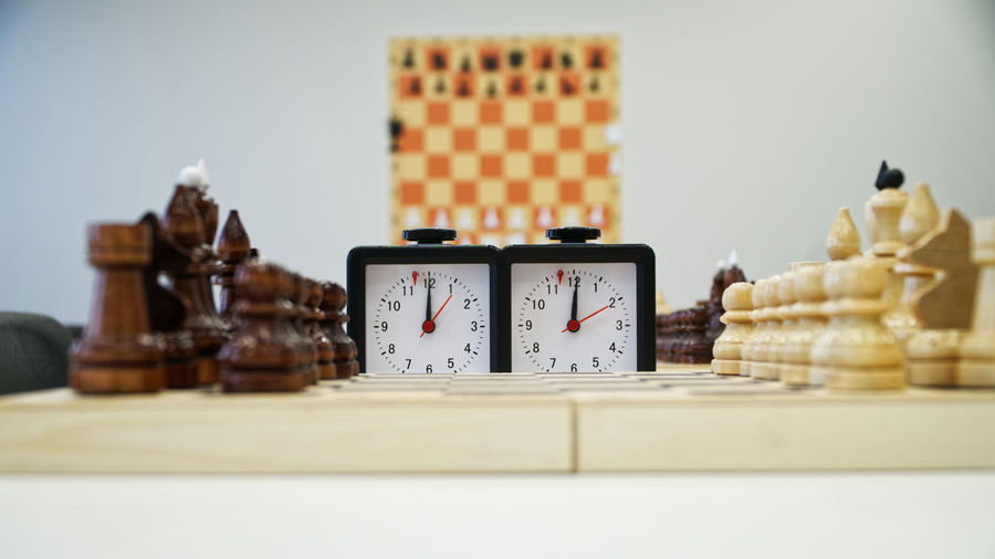 Chess pieces over board on table