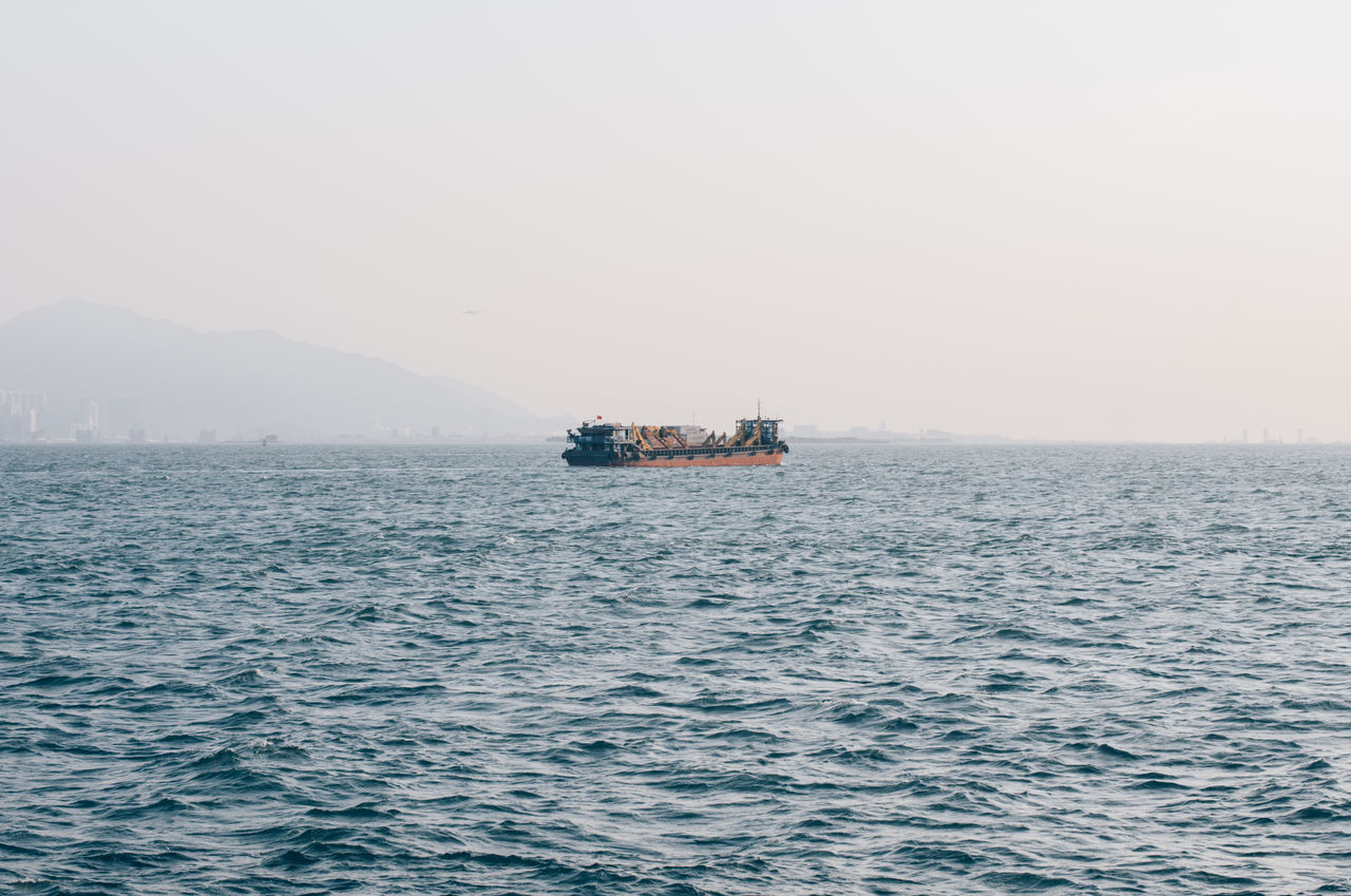 transportation, sea, nautical vessel, nature, waterfront, outdoors, mode of transport, water, beauty in nature, scenics, tranquility, day, fog, no people, sailing, sky