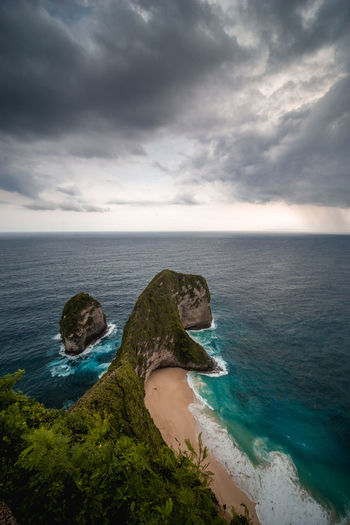 one of the most iconic spot for photo shoot, kelingking beach located in nusa penida Sea Water Sky Cloud - Sky Horizon Over Water Horizon Beauty In Nature Scenics - Nature Land Nature Tranquility Beach Day Tranquil Scene Overcast No People Rock - Object Outdoors