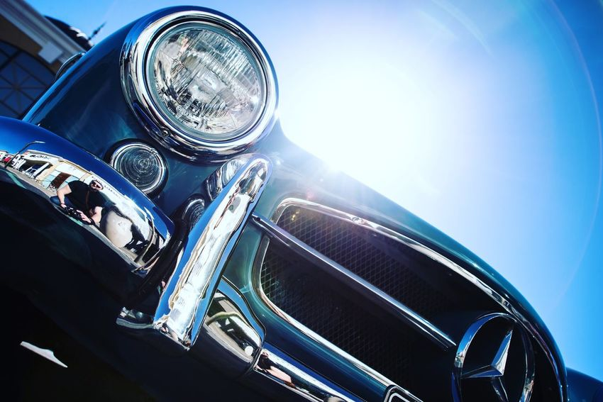 Chrome Benz Sunlight Motor Vehicle Car Blue No People Low Angle View Day Land Vehicle Mode Of Transportation Clear Sky Transportation Shiny Nature Built Structure Metal Architecture Close-up Sky Headlight Outdoors