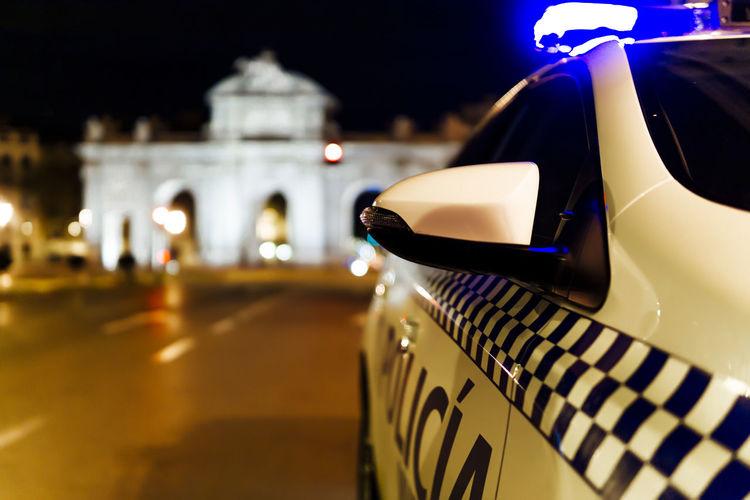 Close-up of illuminated car on street at night