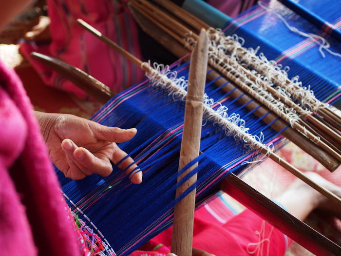 Art And Craft Craft Factory Finger Hand Holding Human Body Part Human Hand Indoors  Industry Loom Occupation One Person Real People Skill  Textile Textile Industry Thread Unrecognizable Person Weaving Working