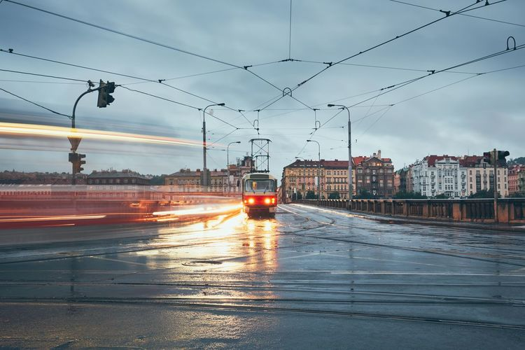 Gloomy day in the city. Tram on the crossroad in the rain. City City Life Rain Road Tram Weather Blurred Motion Built Structure City Cloud - Sky Crossroads Dusk Gloomy Long Exposure Motion Overcast Public Transportation Rail Transportation Road Sky Street Tramway Transportation Urban Wet