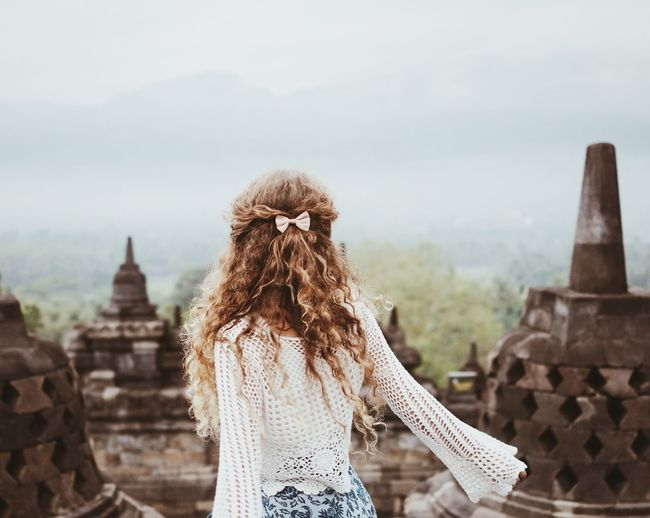 Borobudur Temple INDONESIA ASIA Curly Curly Hair Long Hair Hair Bow Crochet Temple Travel Girl Young Woman