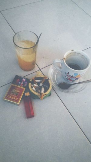Coffee, orange ice, and some smoke make you relaxxx Coffee Time Cigarette  Orange Juice  Omjoko