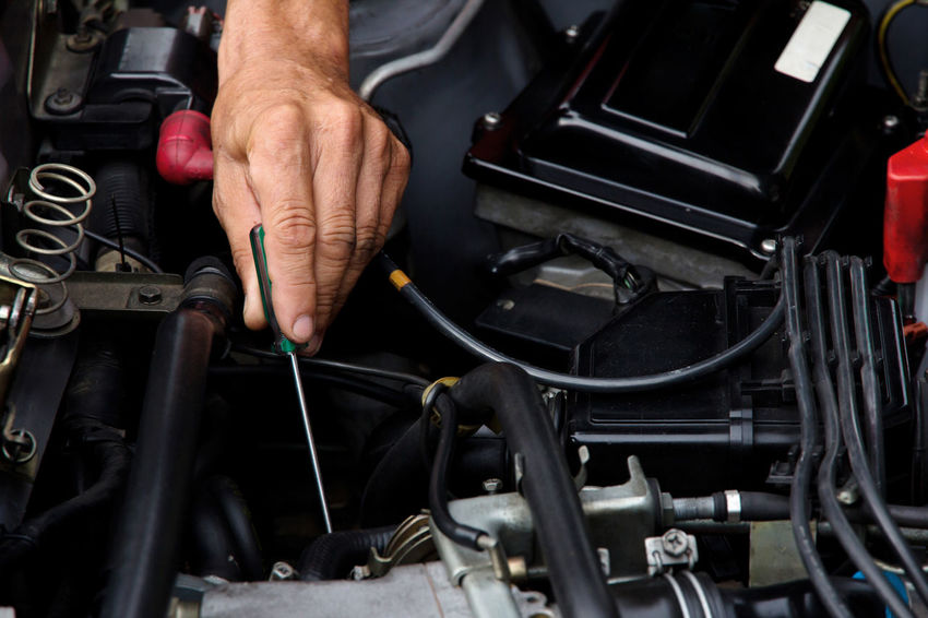 Professional car mechanic, auto repair concept Automobile Repair Shop Repairing Auto Auto Repair Shop Car Engine Close-up Day Garage Human Body Part Human Hand Indoors  Maintainance Mechanic Men Occupation One Man Only One Person People Physical Impairment Real People Repairman Technology Work Tool Working