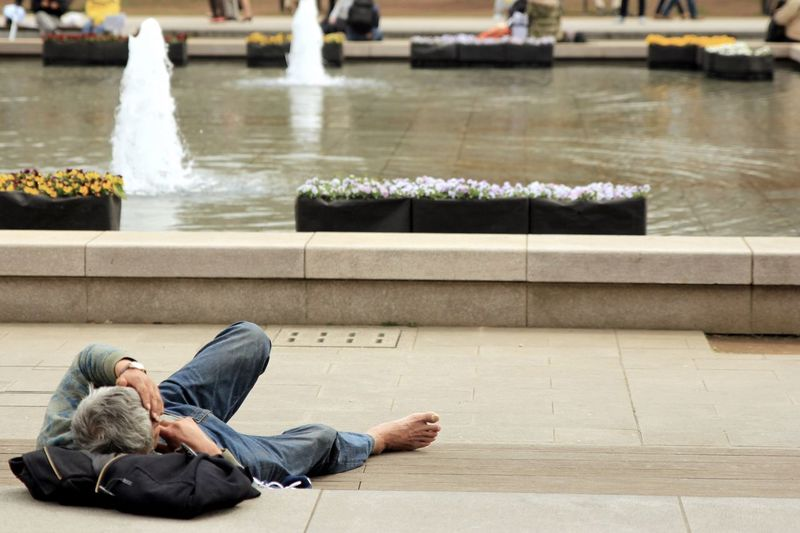 Man lying down on swimming pool