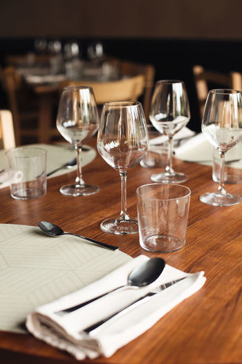 Restaurant Restaurant Italy Wood Silver  Wineglass Wine Alcohol Drinking Glass Drink Table Place Setting Restaurant Red Wine Food And Drink Table Knife Silverware  Prepared Food Empty Plate Fork Napkin Eating Utensil