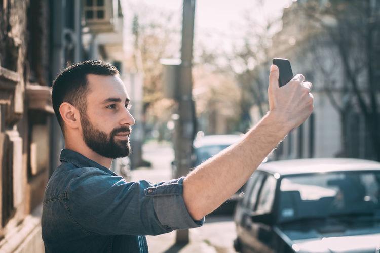 Man Taking Selfie Through Smart Phone